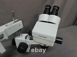 AmScope SM-4B. 7X-4.5X Binocular Stereo Zoom Microscope with Double Arm Boom Stand